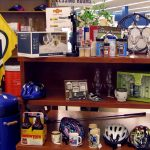 Gifts for Dad at St. Vincent de Paul's Fond du Lac including bike helmets, Packer flags, golf clubs and wine glasses.