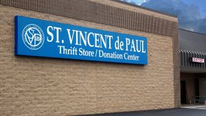St. Vincent de Paul Fond du Lac storefront sign and building.
