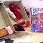 Vintage Barbie dolls and books.