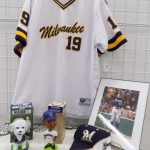 Milwaukee Brewer memorabilia including jersey, hat framed photo and Bobbleheads.