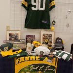 Packer Memorabilia including footballs, hats, jerseys and Brett Favre banner.