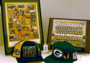 Green Bay Packers memorabilia including hats and plaques.