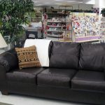 Furniture department with dark brown leather sofa.