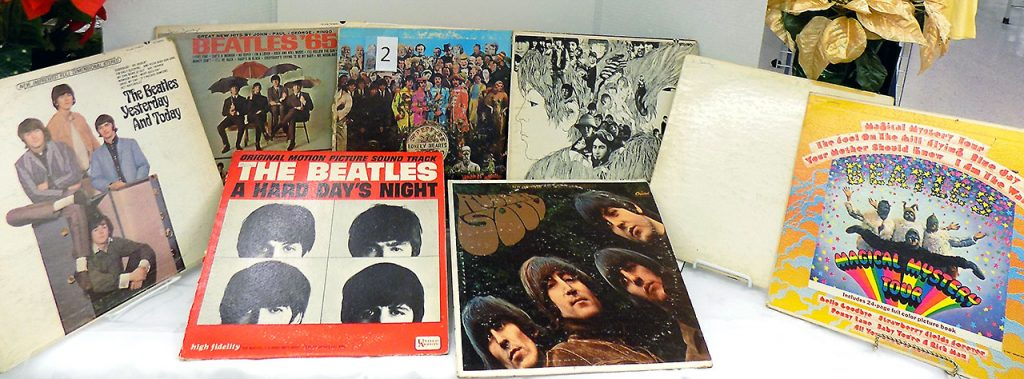 Collection of The Beatles albums including Sgt. Pepper's Lonely Hearts Club, Revolver, Beatles' 65, Magical Mystery Tour, Yesterday and Today, A Hard Day's Night and Rubber Soul.