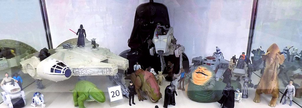 Star Wars action figures and accessories including the Millennium Falcon Spaceship.