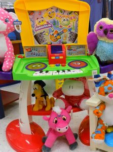 Kids music DJ booth toy and plush animals.