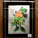 Minnie Mouse picture in frame.