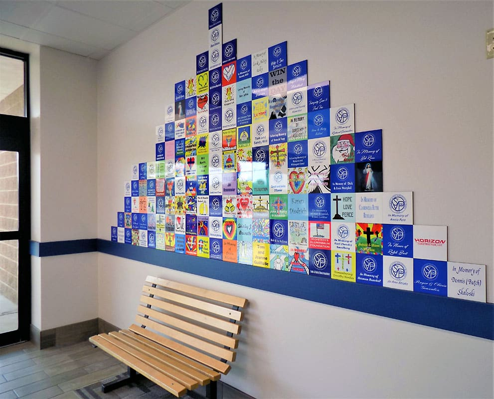 SVDP: Fond du Lac Helping Others Tile wall.