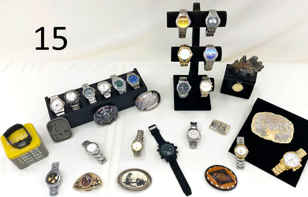Mens watches and belt buckles.